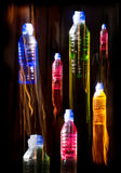 Seven Coloured bottles Royalty Free Stock Images