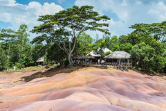 Seven Coloured Earth in Mauritius, Chamarel nature reserve. Chamarel, Mauritius - December 26, 2015: People watching for main sight of Mauritius - Seven Coloured stock photo