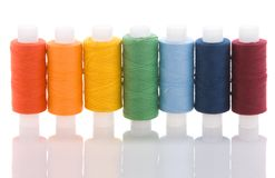 Seven coloured spools. With thread look like rainbow Royalty Free Stock Photography