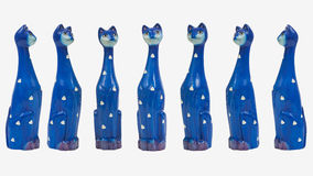 Seven Comical Tall Blue Cats. Seven comical tall blue cat figurines on a white background Royalty Free Stock Image