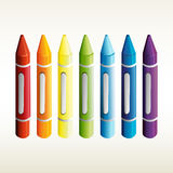 Seven crayons in different colors Stock Photo