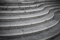 Seven curved modern gray stone stairs Royalty Free Stock Image