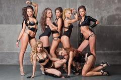 Seven Cute go-go sexy girls in black with diamonds. Costume Stock Photo