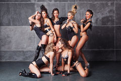 Seven Cute go-go girls in black with diamonds Royalty Free Stock Photography