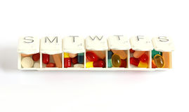 Seven day pill box with pills Stock Image