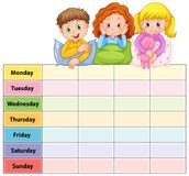 Seven days of the week table with kids in pajamas Stock Photo