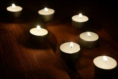 Seven Decorative Lighted Candles Royalty Free Stock Image