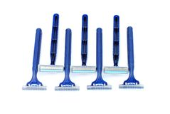 Seven disposable blue razors Royalty Free Stock Photos