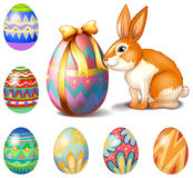 Seven Easter eggs and a bunny Stock Photography