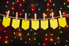 Seven festive flags. On the background of colored lights Stock Images