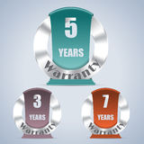 Seven five and three year warranty badges Royalty Free Stock Photo