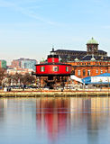 The Seven Foot Knoll Lighthouse in Baltimore Inner Harbor. The lighthouse reflection during sunset Royalty Free Stock Photos