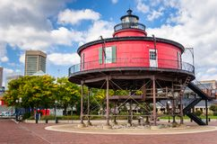 Historic Lighthouse on the Waterfront of Baltimore. Seven Foot Knoll Lighthouse on the Waterfront of Baltimore, MD under Blue Sky with Clouds royalty free stock images
