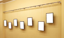 Seven frames with  canvas on the exhibition ledge Royalty Free Stock Images