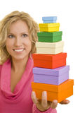 Seven gifts. Young woman holding a stack of seven gift boxes stock images