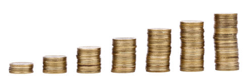 Growing Stacks of Golden Coins royalty free stock photo