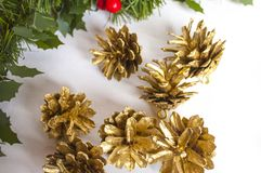 Christmas decorations and golden pine cones Royalty Free Stock Photography