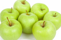 Seven green apples isolated on a white background Royalty Free Stock Images