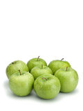 Seven green apples Stock Photography