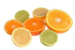 Seven halves of orange, minneola, mandarin, lime and lemon isola. Ted on white background Royalty Free Stock Photography