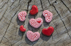 Seven Hearts on Wood Stock Image