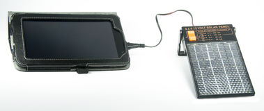 Seven inch tablet with a solar charger Stock Image