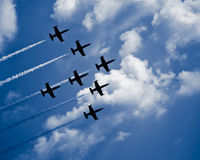 Seven jet airplanes. With white smocks  in arrow formation Stock Photo