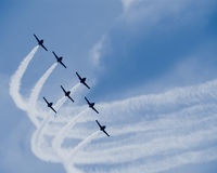 Seven jet airplanes with white smocks. Turning synchronically in formation Stock Photography