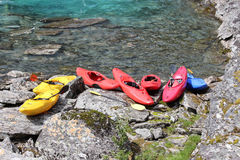 Seven kayaks on the river bank. Stock Photo