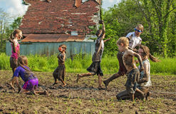 7 Seven kids mud fight Royalty Free Stock Photo