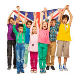 Seven kids raised their hands up with English flag Royalty Free Stock Image