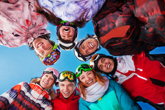 Seven laughing friends in circle wearing goggles Royalty Free Stock Image