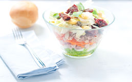 Seven-layer salad with egg, tuna, dried tomatoes Royalty Free Stock Images