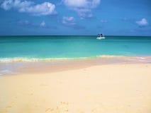Seven Mile Beach Grand Cayman. Boat on Seven Mile Beach in Grand Cayman Stock Photos