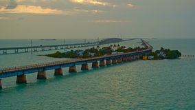 Seven mile bridge at sunset on a windy day. Iconic aerial of Seven mile bridge at sunset on a windy day on Atlantic ocean stock footage