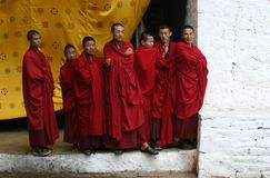 Seven Monks. Seven buddhist monks watching a rehearsal for punakha tsechu (dance festival) in one inner courtyard at punakha dzong in bhutan The Punakha Dzong royalty free stock image