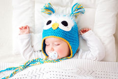 Seven month old baby sleeping in the bed Royalty Free Stock Photo