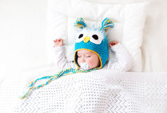 Seven month old baby sleeping in the bed Stock Photo