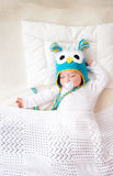 Seven month old baby sleeping in the bed Royalty Free Stock Photography