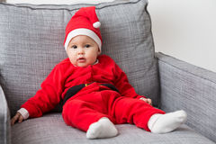Seven months old baby girl in Santa Claus dress Stock Photography