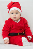 Seven months old baby girl in Santa Claus dress Stock Image