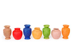 Seven multicolor vases. Royalty Free Stock Photo