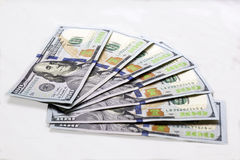 Seven new hundred-dollar banknotes on white background. Earning income money from real estate transactions. Seven new type hundred-dollar banknotes on white Stock Photos