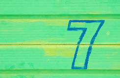 Seven. Number seven painted on a battered metal door Royalty Free Stock Photography