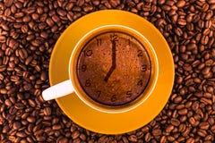 Seven o`clock on fresh espresso with a beautiful crema Stock Image