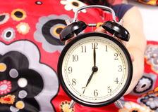 Seven o'clock indicated on the alarm clock Royalty Free Stock Photos
