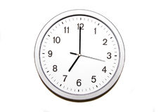 Seven o`clock. Wall clock isolated on white and signing the seven o clock hour - part of 12 hours series Royalty Free Stock Image
