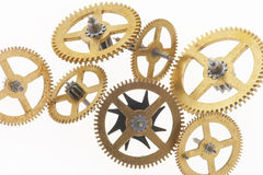 Seven old golden cogwheels. Many old gold-coloured little cogwheels are connected Royalty Free Stock Photos