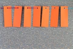 Seven orange rectangular tags Royalty Free Stock Photos