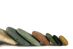 Seven pebbles line Royalty Free Stock Image